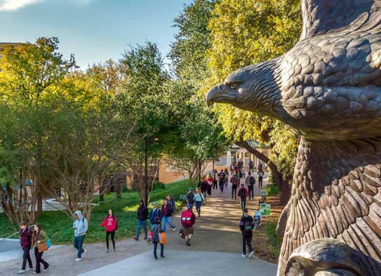 University of North Texas students walk between classes near the eagle statue.