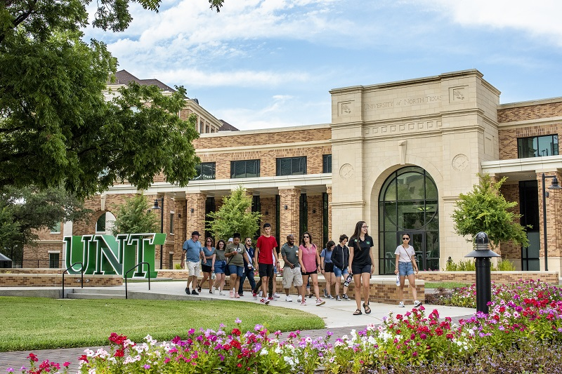 UNT students walking at the new UNT welcome center
